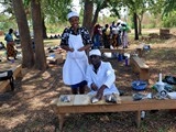 Chefs demonstrating fish processing