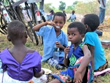 Children tasting porridge