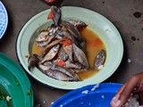 Lunch break...mostly small fish, some vegetables and Nsima