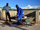 Preparing cement for the stands of the tray for the solar panels